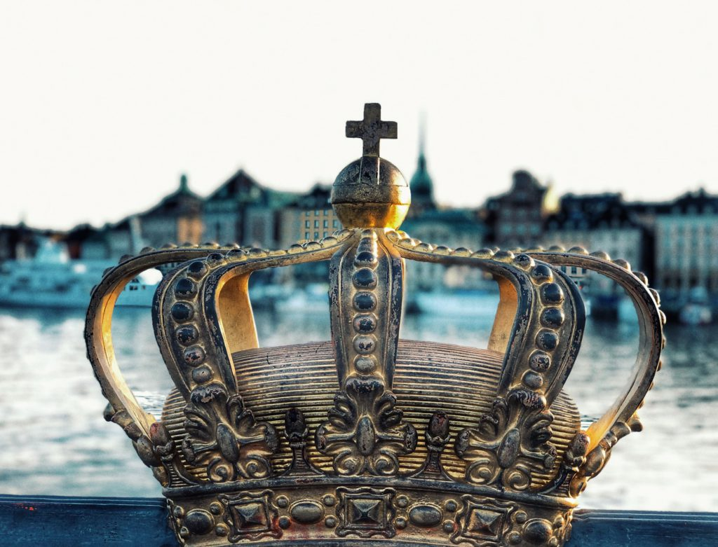 A gold crown with sea background, captured in Stockholm Sweden