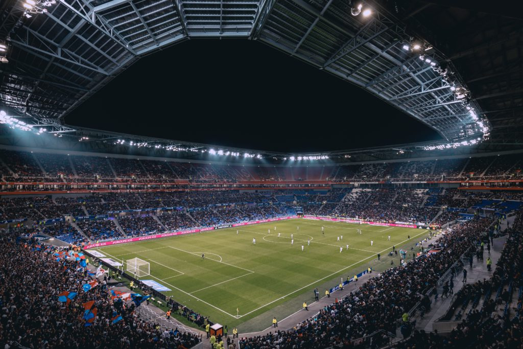 Euro 2020 football games. the stadium is full of people and the game is on.